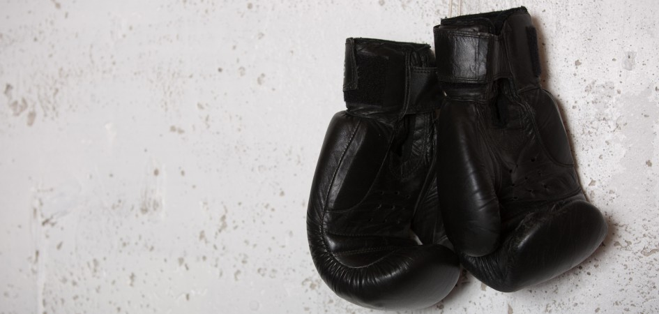 boxing gloves hanging on a wall